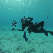 Instructor Diving Under Water