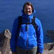 Cort standing next to Crater Lake